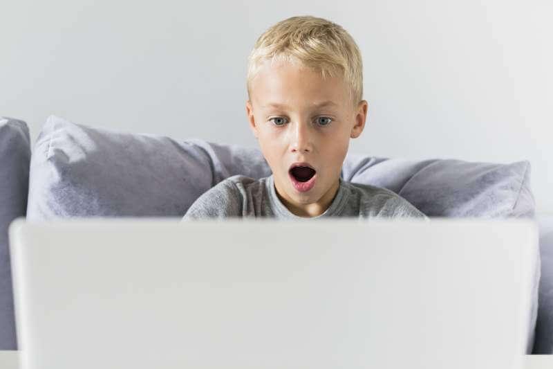 Little-boy-having-fun-with-laptop