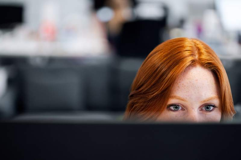 female-software-engineer-coding-on-computer